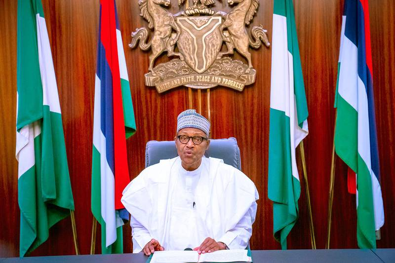 In this photo released by the Nigeria State House, Nigeria's President Muhammadu Buhari, address the nation on a live televised broadcast, Thursday, Oct. 22, 2020. Buhari has spoken to the nation about the unrest that has gripped the country in recent days but without mentioning the shootings of peaceful protesters at Lekki toll plaza on Tuesday night that prompted international outrage. (Bayo Omoboriowo/Nigeria State House via AP)