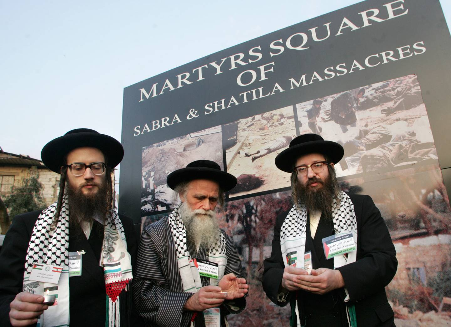 Rabbis from left, David Shlomo Feldman, Moshe Dov Beck and Yisroel Dovid Wiess, light candles at the Martyrs square of Sabra and Shatila Massacres in the Palestinian refugee camp in Beirut, Lebanon, Thursday Feb. 24, 2005. Four Jewish Rabbis are taking part in a three-day conference titled The Palestinian People's Right of Return to their Homeland. The conference is organized by The International Union of Parliamentarians for the Defense of the Palestinian Cause that includes members of parliament from around the world. (AP Photo/Adnan Hajj Ali)