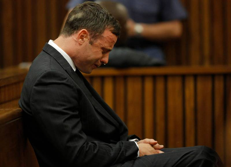 Oscar Pistorius cries in the dock in Pretoria, South Africa, Thursday, Sept. 11, 2014 as Judge Thokozile Masipa reads notes as she delivers her verdict in Pistorius' murder trial. Masipa appeared to be heading for a culpable homicide finding after ruling out both premeditated murder and murder verdicts in the shooting death of the double-amputee Olympic athlete's girlfriend, Reeva Steenkamp. (AP Photo/Kim Ludbrook, Pool) / TT / kod 436