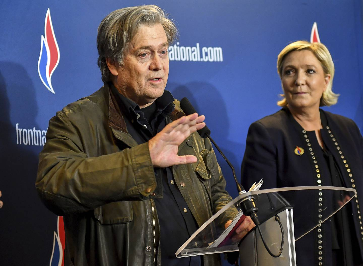 FILE - In this Saturday, March 10, 2018 file photo, former White House strategist Steve Bannon holds a press conference with National Front party leader Marine Le Pen, right, at the party congress in the northern French city of Lille. French far-right leader Le Pen distanced herself Monday, Oct. 8, 2018 from former White House strategist Steve Bannon, saying only Europeans will save the continent from diktats from Brussels, not Americans. (AP Photo, File)