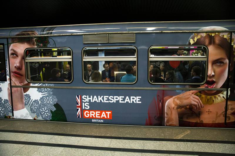 An underground train painted with William Shakespeare's heroes, carries passengers and waits for a signal, in Moscow, Russia, Tuesday, May  24, 2016.  The Moscow metro unveiled a train to mark the language and literature of William Shakespeare on the 400th anniversary of his death.  (AP Photo/Pavel Golovkin)