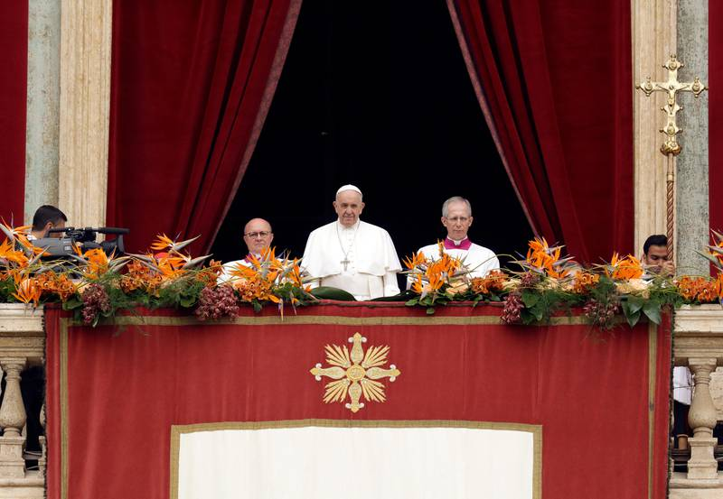 """Pope Francis, center, delivers his """"Urbi et Orbi"""" (""""to the city and the world"""") message, in St. Peter's Square at the Vatican, Sunday, April 21, 2019. Pope Francis celebrated Easter Mass on Sunday, marking the most joyful moment of the year for the faithful even as the church faced a fresh round of bloodshed targeting Christians in Sri Lanka. (AP Photo/Andrew Medichini)"""