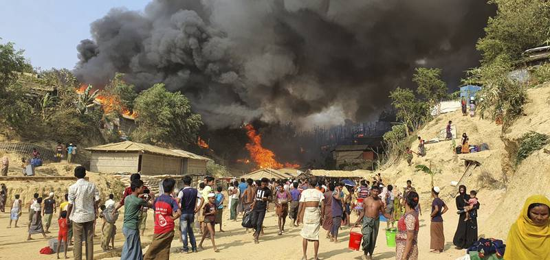 Smoke rises following a fire at the Rohingya refugee camp in Balukhali, southern Bangladesh, Monday, March 22, 2021. The fire destroyed hundreds of shelters and left thousands homeless, officials and witnesses said. (AP Photo/ Shafiqur Rahman)