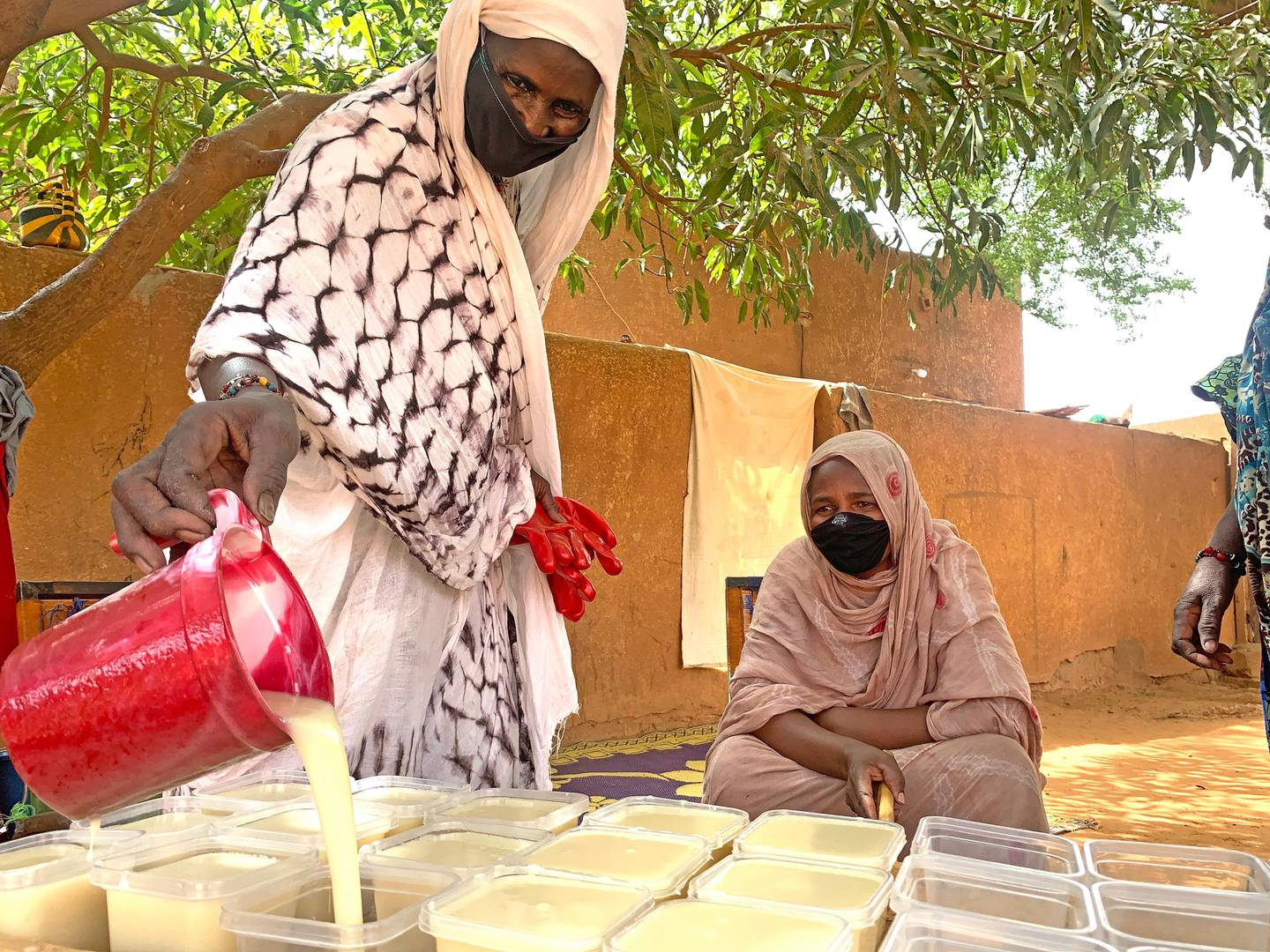 Every week, the soap factory produces about 30 pieces of soap that these women from the Tuareg refugee community sell to the population. ; In Hamdallaye, in Diffa (Sayam Forage camp) but also in Niamey, Tillabéry and Ouallam, refugees have  been trained to make soap (pieces and liquid) and bleach in the past within the framework of UNHCR projects. This activity generates income but is also part of the national fight against the coronavirus. ; This image, video, audio or multimedia is copyrighted and may only be reproduced with permission from authorised staff at UNHCR. Images, video, audio and multimedia may only be used under licence for editorial use relating to UNHCR-supported issues and only where the content of the media is accurately represented and captioned. Use in a commercial or promotional context or for fundraising is not allowed without UNHCR's consent. A credit is always required in the format '© UNHCR/Photographer' for photo images and '© UNHCR' for video, audio and multimedia unless stated otherwise.