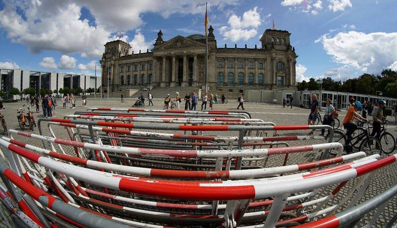 Crowd control barriers are placed in front of the Reichstag building, home of the German federal parliament (Bundestag), in Berlin, Germany, Monday, Aug. 31, 2020. (AP Photo/Michael Sohn)