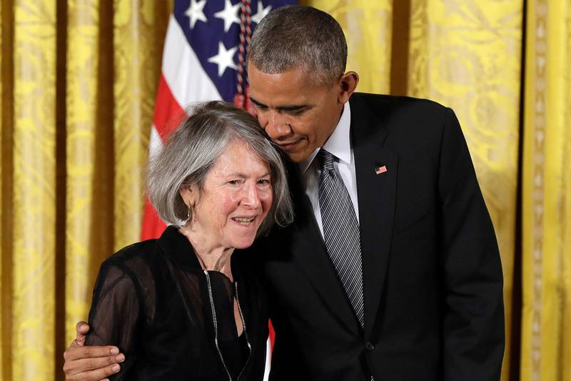 """FILE - In this Thursday, Sept. 22, 2016 file photo, President Barack Obama embraces poet Louise Gluck before awarding her the 2015 National Humanities Medal during a ceremony in the East Room of the White House, in Washington. The 2020 Nobel Prize for literature has been awarded to American poet Louise Gluck """"for her unmistakable poetic voice that with austere beauty makes individual existence universal."""" The prize was announced Thursday Oct. 8, 2020 in Stockholm by Mats Malm, the permanent secretary of the Swedish Academy. (AP Photo/Carolyn Kaster, File)"""