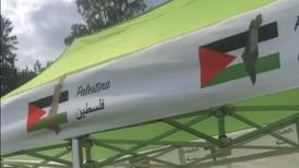 Norway Cup teipet over flagg og kart på Palestina-telt