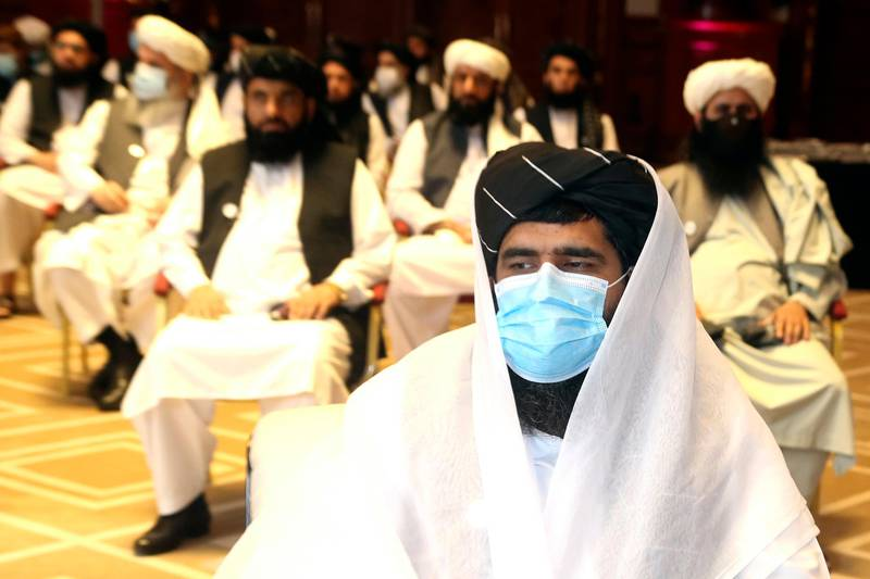 A member of Taliban negotiation delegation, keeps his face mask during the opening session of the peace talks between the Afghan government and the Taliban in Doha, Qatar, Saturday, Sept. 12, 2020. (AP Photo/Hussein Sayed)