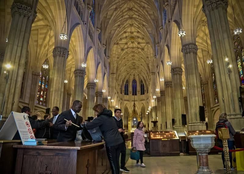 Church security screen visitors to St. Patrick's Cathedral, as religious institutions tighten security in the aftermath of Pittsburgh's Synagogue shooting, Monday Oct. 29, 2018, in New York. (AP Photo/Bebeto Matthews)