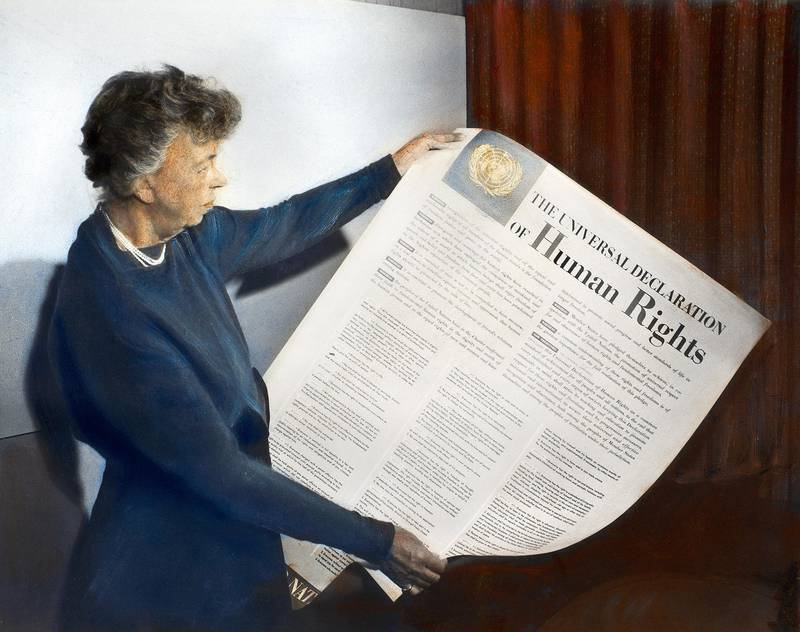 ANNA ELEANOR ROOSEVELT (1884-1962). Mrs. Franklin Delano Roosevelt. Eleanor Roosevelt holding a Universal Declaration of Human Rights poster at Lake Success, New York. Oil over a photograph, November 1949.