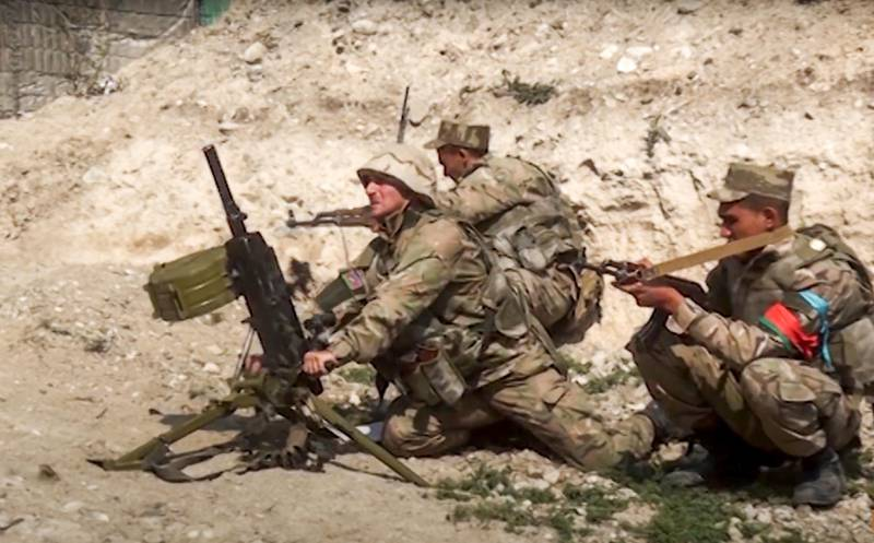 In this image taken from footage released by Azerbaijan's Defense Ministry on Sunday, Sept. 27, 2020, Azerbaijan's soldiers fire from a mortar at the contact line of the self-proclaimed Republic of Nagorno-Karabakh, Azerbaijan. Fighting between Armenian and Azerbaijani forces over the disputed separatist region of Nagorno-Karabakh continued on Monday morning after erupting the day before, with both sides blaming each other for resuming the attacks. (Azerbaijan's Defense Ministry via AP)