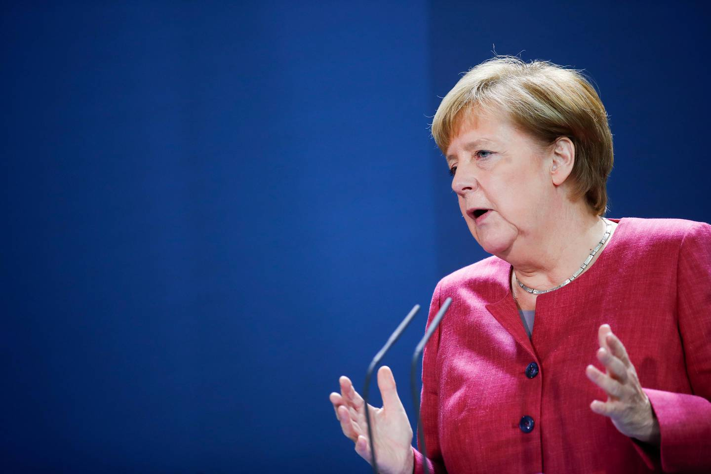 German Chancellor Angela Merkel gives a media statement after a video conference with mayors of German cities on the spread of the coronavirus disease, in Berlin, Germany, Oct. 9, 2020. (Axel Schmidt/Pool via AP)