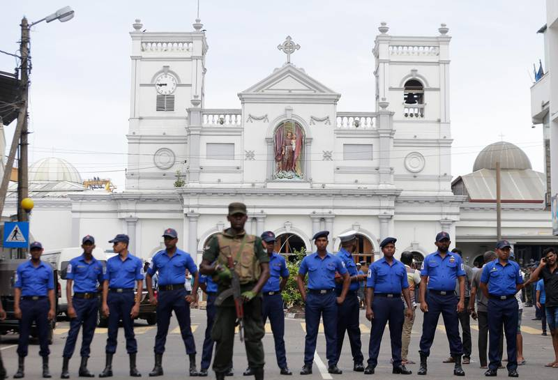 Sri Lankan Army soldiers secure the area around St. Anthony's Shrine after a blast in Colombo, Sri Lanka, Sunday, April 21, 2019. A Sri Lanka hospital spokesman says several blasts on Easter Sunday have killed dozens of people. (AP Photo/Eranga Jayawardena)