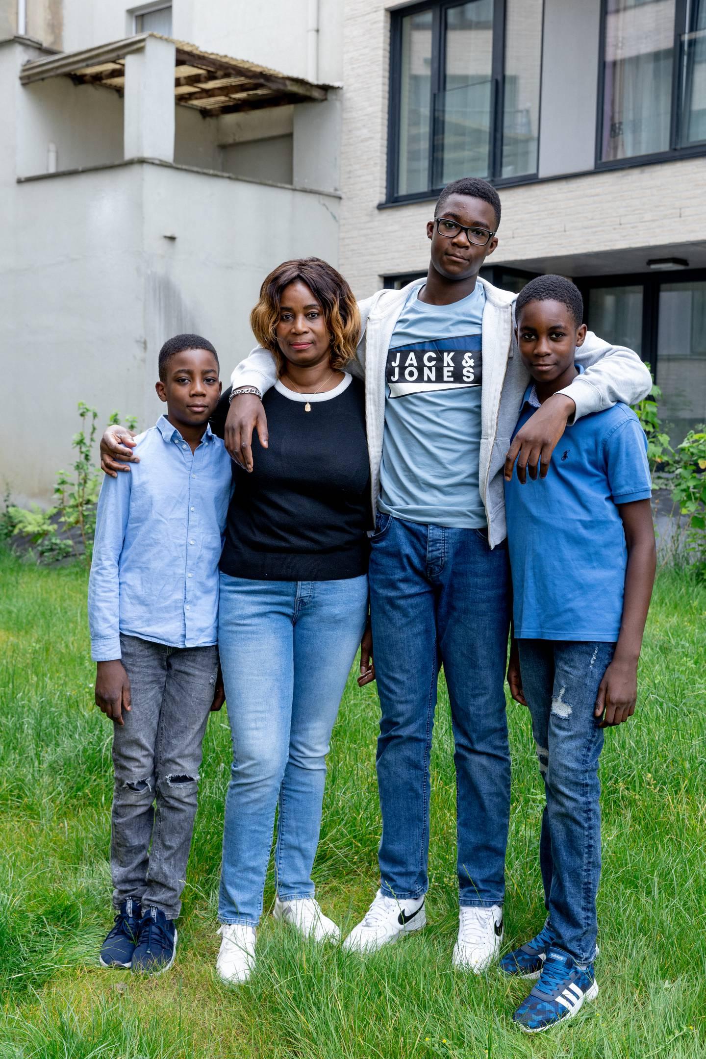 Akakpo Family in front of Arc-en-Ciel homes - photo Ines Van Steenkiste