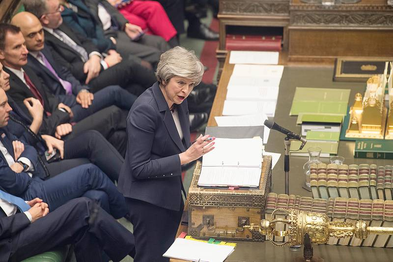 Britain's Prime Minister Theresa May speaks during Prime Minister's Questions in the House of Commons, London, Wednesday, Jan. 9, 2019.  The British government brought its little-loved Brexit deal back to Parliament on Wednesday, a month after postponing a vote on the agreement to stave off near-certain defeat. (©UK Parliament /Mark Duffy via AP)