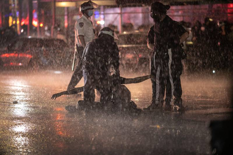 Police arrest protesters for breaking a curfew by marching through Manhattan during a solidarity rally calling for justice over the death of George Floyd, Wednesday, June 3, 2020, in New York. Floyd died after being restrained by Minneapolis police officers on May 25. (AP Photo/Wong Maye-E)