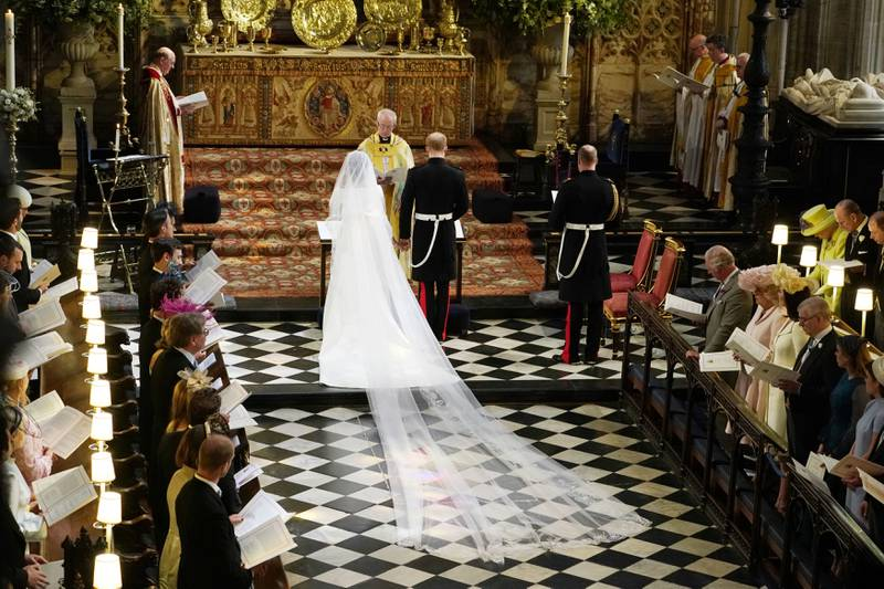 Britain's Prince Harry and Meghan Markle stand in front of Archbishop of Canterbury Justin Welby during their wedding