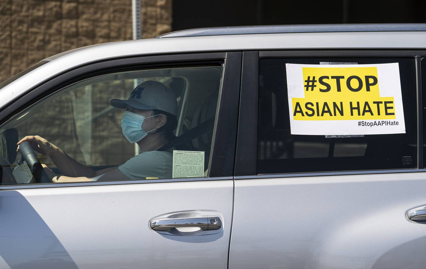 """FILE - In this March 19, 2021, file photo, members of the Korean American Federation of Los Angeles drive with signs reading: """"#Stop Asian Hate,"""" in a caravan around Koreatown to denounce hate against the Asian American and Pacific Islander communities in Los Angeles. After more than a year filled with attacks on Asian Americans unfairly blamed for the coronavirus, a majority of Americans across racial and ethnic groups believe anti-Asian American discrimination has worsened over the last year. A poll from the The Associated Press-NORC Center for Public Affairs Research finds nearly half of Americans believe Asian Americans encounter """"a great deal"""" or """"quite a lot"""" of discrimination. (AP Photo/Damian Dovarganes, File)"""