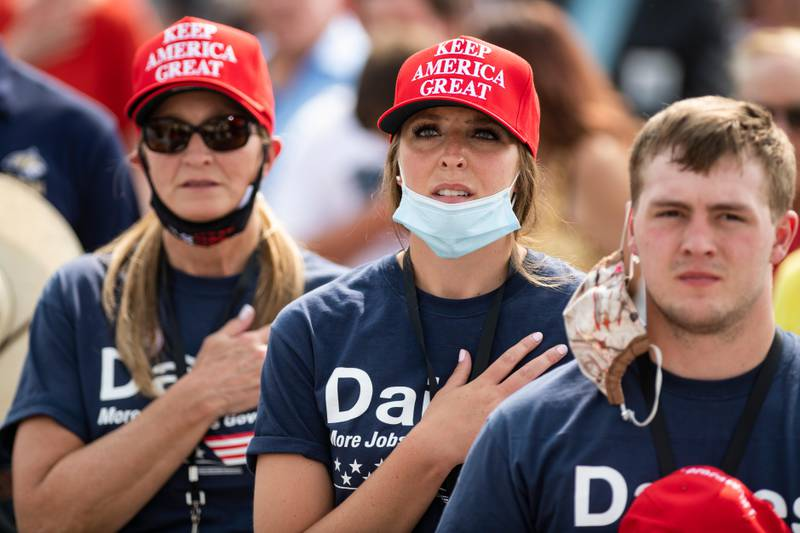 Attendees of the Republican campaign rally for for Sen. Steve Daines, R-Mont., and attended by Vice President Mike Pence say the pledge of allegiance in Belgrade, Mont. on Monday, Sept. 14, 2020. (AP Photo/Tommy Martino)