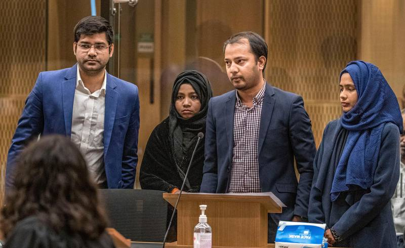 Mohammad Alam, second right, makes his victim impact statement during the sentencing hearing for Australian Brenton Harrison Tarrant at the Christchurch High Court after Tarrant pleaded guilty to 51 counts of murder, 40 counts of attempted murder and one count of terrorism in Christchurch, New Zealand, Monday, Aug. 24, 2020. (John Kirk-Anderson/Pool Photo via AP)