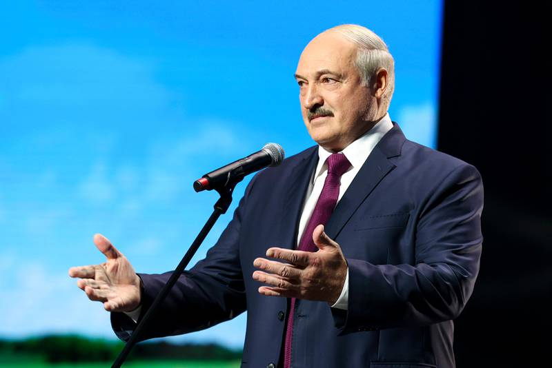 Belarusian President Alexander Lukashenko gestures while addressing a women's forum in Minsk, Belarus, Thursday, Sept. 17, 2020. Lukashenko has given a speech at a women's forum with some good quotes—he's announced Belarus will close the border with Ukraine, Poland and Lithuania, and is mobilizing half the army. (BelTA Pool Photo via AP)