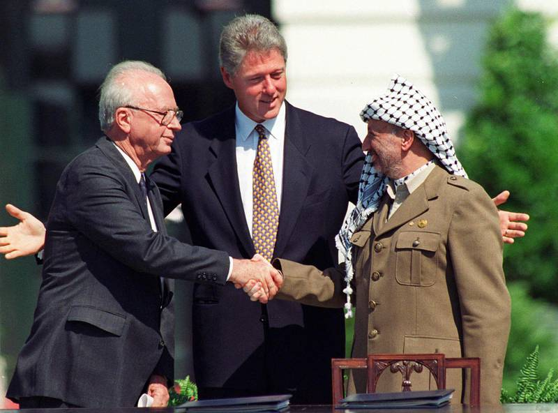 FILE - In this Sept. 13, 1993 file photo, U.S. President Clinton presides over White House ceremonies marking the signing of the peace accord between Israel and the Palestinians with Israeli Prime Minister Yitzhak Rabin, left, and Palestinian leader Yasser Arafat, right, in Washington. The most promising diplomatic effort between Palestinians and Israelis took place - much of it in secret - in Oslo, Norway between 1991 and 1993, which produced the Oslo Accords, the foundation of diplomacy there ever since. The agreement, the first face-to-face deal between Israel and the Palestinians, provided for an interim Palestinian self-governing entity. (AP Photo/Ron Edmonds, File)