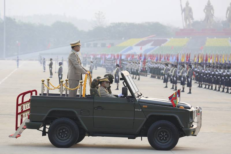 Commander-in-Chief Senior General Min Aung Hlaing reviews the troops during an army parade on Armed Forces Day in Naypyitaw, Myanmar, March. 27, 2021. (AP Photo)