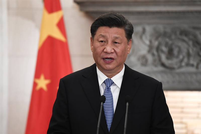 China's President Xi Jinping attends a joint media conference with Greece's Prime Minister Kyriakos Mitsotakis, after their meeting at Maximos Mansion in Athens, Monday, Nov. 11, 2019. Xi Jinping is in Greece on a two-day official visit. (Aris Messinis/Pool via AP)
