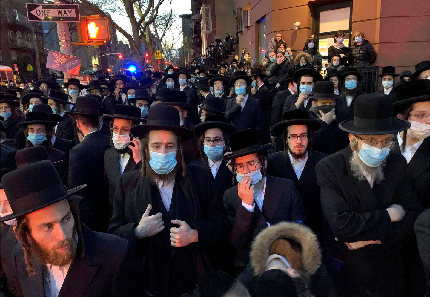 """Hundreds of mourners gather in the Brooklyn borough of New York, Tuesday, April 28, 2020, to observe a funeral for Rabbi Chaim Mertz, a Hasidic Orthodox leader whose death was reportedly tied to the coronavirus. The stress of the coronavirus' toll on New York City's Orthodox Jews was brought to the fore on Wednesday after Mayor Bill de Blasio chastised """"the Jewish community"""" following the breakup of the large funeral that flouted public health orders.(Peter Gerber via AP)"""