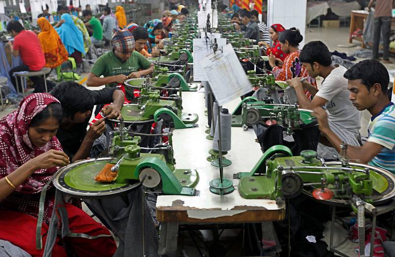 FILE - In this Saturday, Dec. 8, 2012 file photo, Bangladeshi garment workers manufacture clothing at a factory on the outskirts of  Dhaka, Bangladesh. Authorities in Bangladesh said during a five-day visit by a delegation of the U.S. Trade Representative?s office ending Wednesday, Sept. 23, 2015, they have met a set of conditions put forward by the United States for better factory safety and workers? rights that were essential to win back preferential trade status that the impoverished South Asian nation lost in 2013 after two deadly factory disasters. The collapse of Rana Plaza and a fire at another factory, Tazreen Fashions, that same year left about 1,500 workers dead and hundreds injured. The garment industry is crucial to Bangladesh?s economy as it employs about 4 million workers, mostly rural women, and many other sectors including banks are heavily dependent on it. (AP Photo/A.M. Ahad, File)