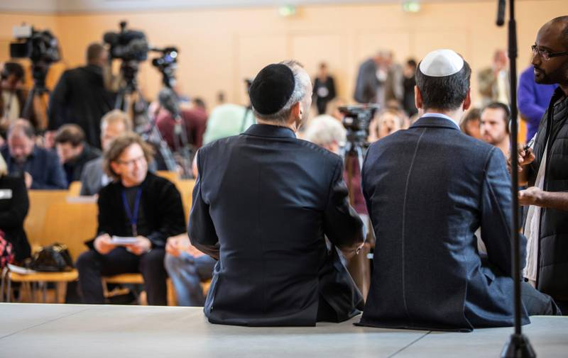 Two men wait for the beginning of a press conference as part of the founding of the 'National Association Of Jews In the Alternative Fuer Deutschland' party in Wiesbaden, Germany, Sunday, Oct. 7, 2018. The far-right Alternative for Germany party has announced it will create a Jewish section within the party, drawing widespread criticism by Jewish groups across the country. (Frank Rumpenhorst/dpa via AP)