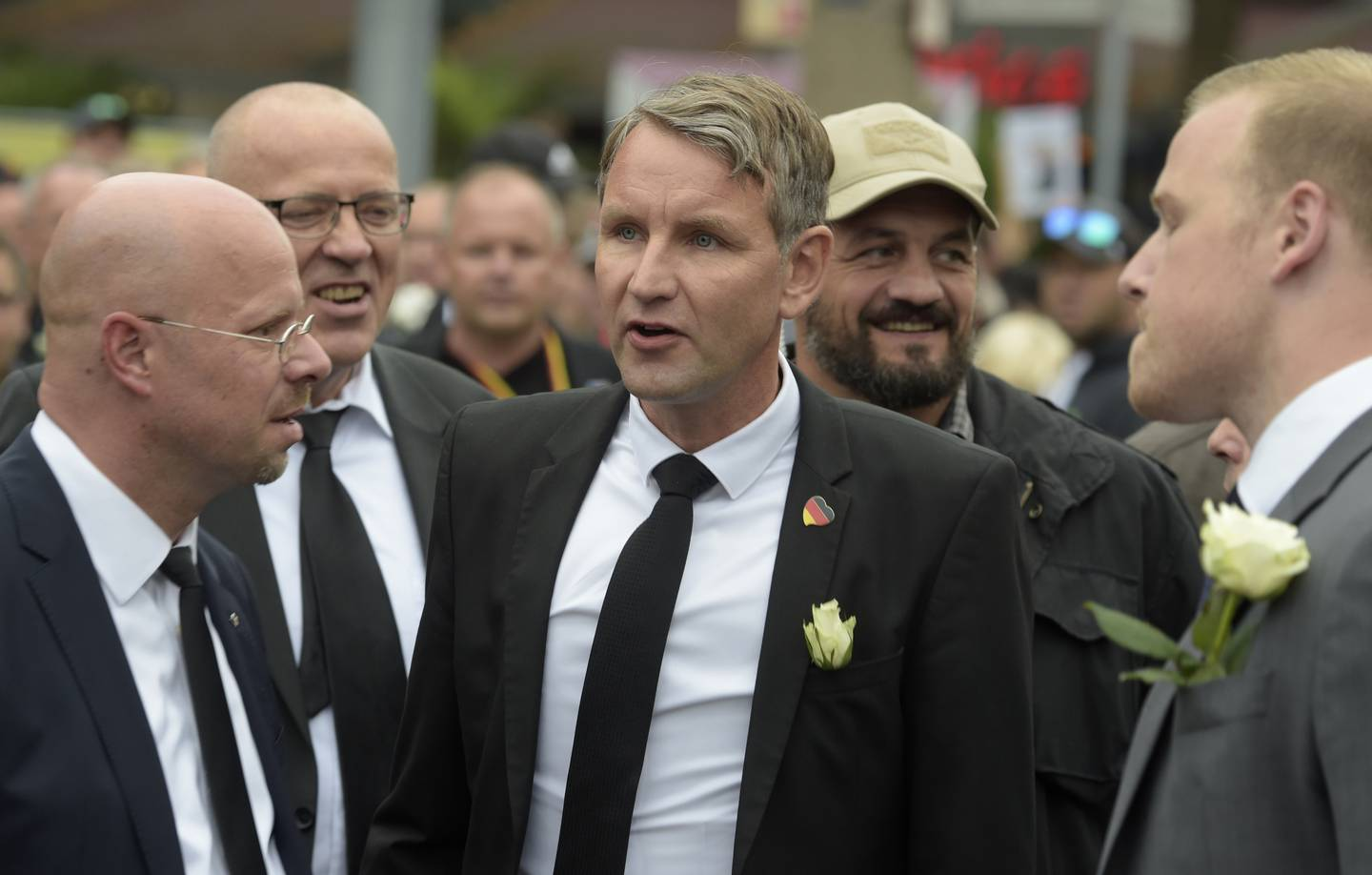 CORRECTS SPELLING - Bjoern Hoecke, center, leader of the Alternative for Germany, AfD, in German state of Thuringia, participates in a commemoration march in Chemnitz, eastern Germany, Saturday, Sept. 1, 2018, after several nationalist groups called for marches protesting the killing of a German man last week, allegedly by migrants from Syria and Iraq. (AP Photo/Jens Meyer)