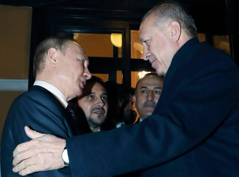 Russian President Vladimir Putin, left, and Turkish President Recep Tayyip Erdogan speak after a joint news conference after their talks in the Kremlin, in Moscow, Russia, Thursday, March 5, 2020. Putin and his Turkish counterpart Erdogan say they have reached agreements that could end fighting in northwestern Syria. (Presidential Press Service via AP, Pool)