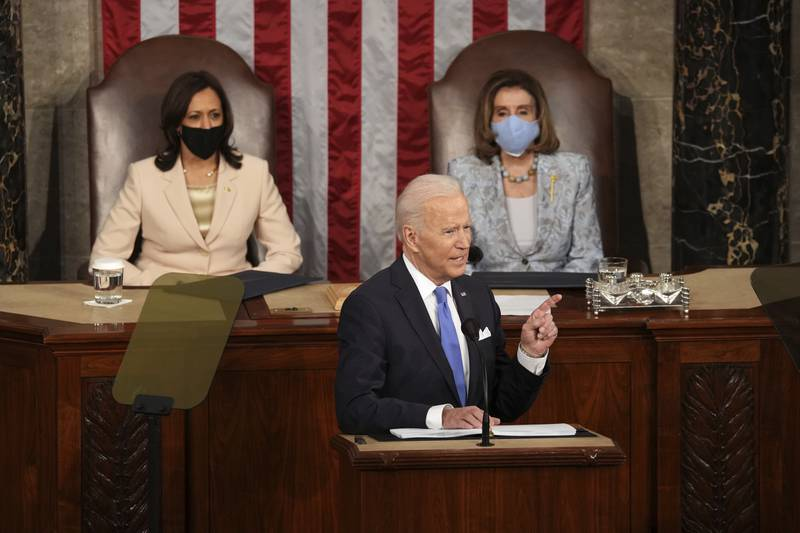 President Joe Biden speaks to a joint session of Congress Wednesday, April 28, 2021, in the House Chamber at the U.S. Capitol in Washington, as Vice President Kamala Harris and House Speaker Nancy Pelosi of Calif., listen. (Doug Mills/The New York Times via AP, Pool)