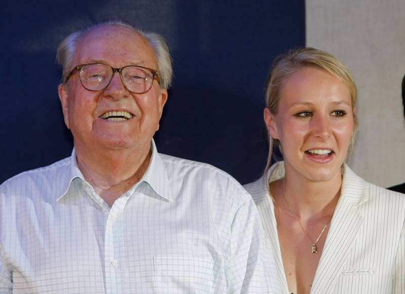 National Front party candidate for French legislative elections Marion Marechal-Le Pen, right, niece of far-right National-Front party leader Marine Le Pen, reacts with her  grandfather, former leader and honorary president of the far-right National-Front party Jean-Marie Le Pen, left,  after her election, during the second round of French legislative elections,  Carpentras, southern France, Sunday, June 17, 2012. (AP Photo/Claude Paris)