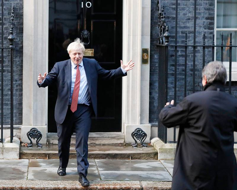 Britain's Prime Minister Boris Johnson leaves 10 Downing Street to welcome the President of the European Parliament David Sassol, right, in London, Tuesday, Oct. 8, 2019.(AP Photo/Frank Augstein)