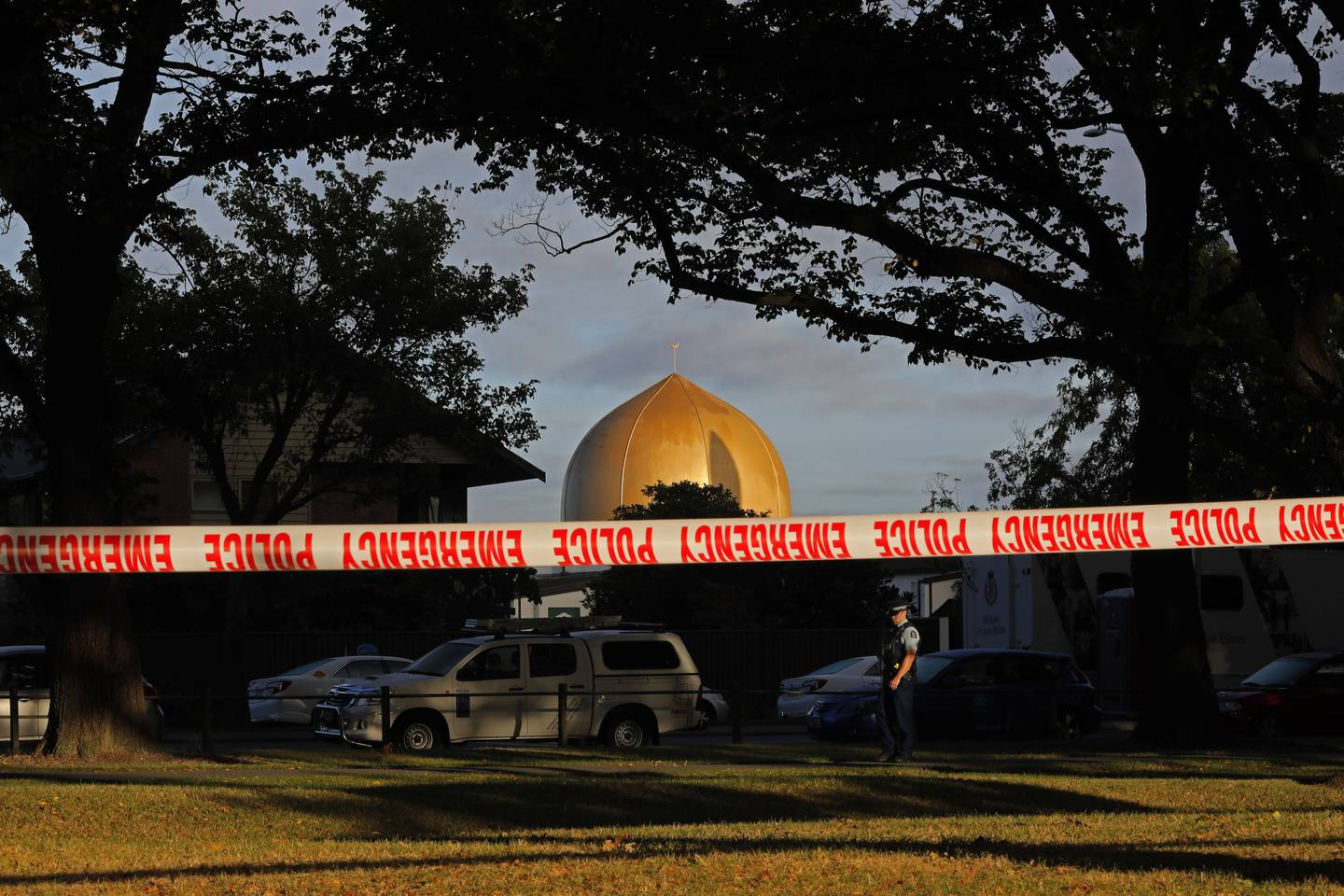FILE - In this March 17, 2019, file photo, a police officer stands guard in front of the Masjid Al Noor mosque in Christchurch, New Zealand, where one of two mass shootings occurred. Growing certainty that a single gunman was responsible for the attacks renews attention to warnings about the threat of terror attacks by ideologically driven lone actors. But stereotypes of such attackers, often called ?Äúlone wolves?Äù in the U.S., risks obscuring the fact that many are not as solitary as some might believe, criminologists say. (AP Photo/Vincent Yu, File)