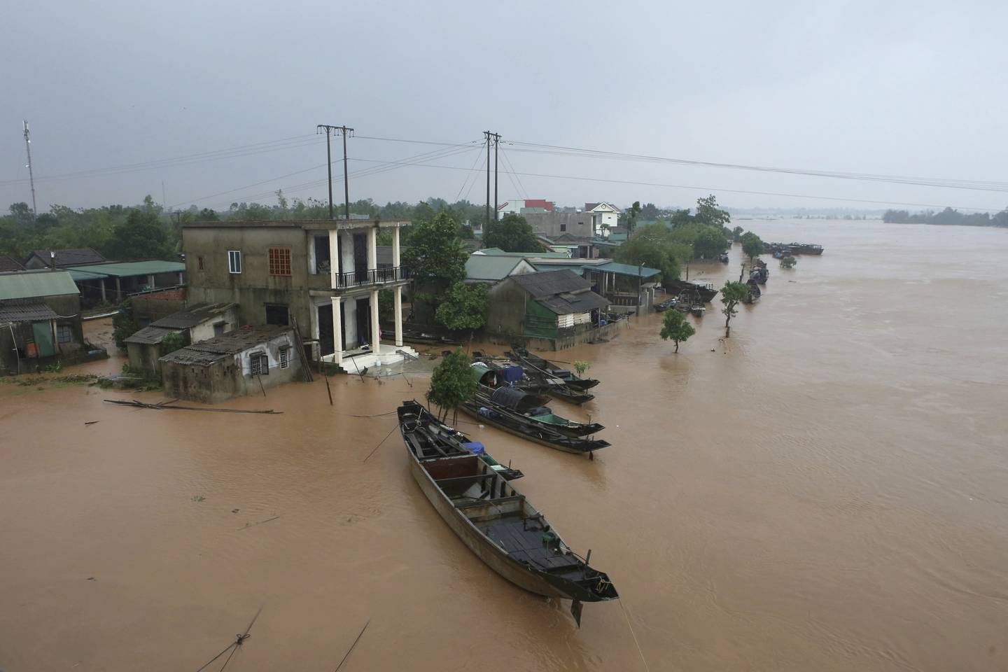 This aerial view shows a flooded village in Quang Tri province, Vietnam, Monday, Oct. 12, 2020. Torrential rains have flooded central Vietnam since last week as the region braces for more heavy rainfall. (Ho Cau/VNA via AP)