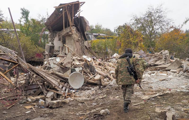 Ethnic Armenian soldiers examine a house destroyed by shelling by Azerbaijan's artillery in Stepanakert, the separatist region of Nagorno-Karabakh, Friday, Nov. 6, 2020. Nagorno-Karabakh authorities said that three civilians were killed by Azerbaijani shelling of the regional capital, Stepanakert on Friday. (AP Photo)