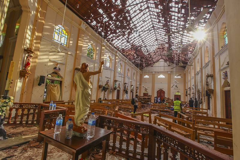 FILE - This Sunday, April 21, 2019, file photo shows the interiors of St. Sebastian's Church damaged in a blast in Negombo, north of Colombo, Sri Lanka. Sri Lankans commemorated the anniversary of last year's Islamic State group-inspired Easter Sunday bomb attacks from their homes on Tuesday amid the coronavirus pandemic. More than 260 people were killed when three churches, two Catholic and one Protestant, came under simultaneous suicide bomb attacks during Easter celebrations on April 21, 2019. Three tourist hotels were also targeted, killing some 42 foreign nationals. (AP Photo/Chamila Karunarathne, File)