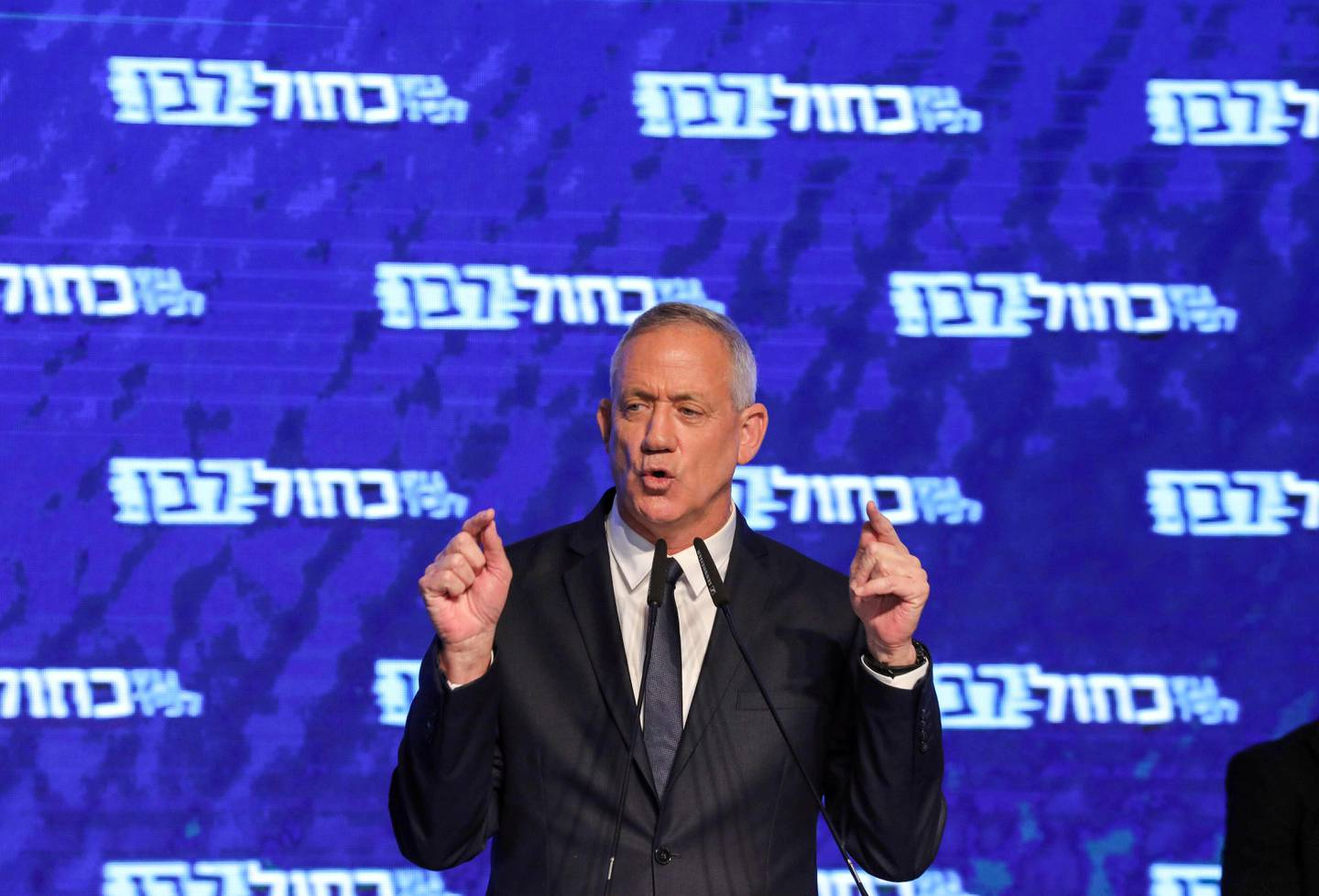 Retired Israeli general Benny Gantz, one of the leaders of the Blue and White (Kahol Lavan) political alliance, speaks before supporters at the alliance headquarters in Tel Aviv on April 10, 2019. (Photo by GALI TIBBON / AFP)