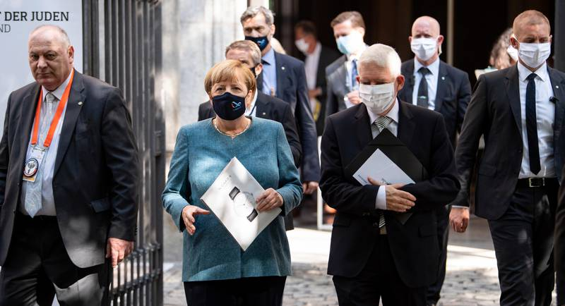 Chancellor Angela Merkel and Josef Schuster, President of the Central Council of Jews in Germany, leave the courtyard of the New Synagogue after the ceremony to mark the 70th anniversary of the Central Council of Jews in Berlin, Germany, Tuesday, Sept. 15, 2020. The Central Council of Jews in Germany was founded on 19 July 1950 in Frankfurt am Main. (Bernd von Jutrczenka/Pool via AP)