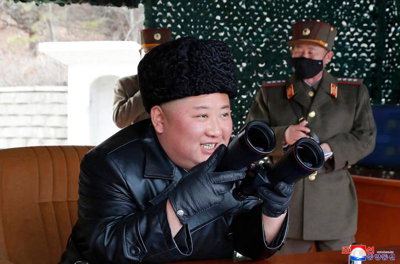 """In this photo provided by the North Korean government, North Korean leader Kim Jong Un inspects a military drill at undisclosed location in North Korea on Monday, March 2, 2020. Independent journalists were not given access to cover the event depicted in this image distributed by the North Korean government. The content of this image is as provided and cannot be independently verified. Korean language watermark on image as provided by source reads: """"KCNA"""" which is the abbreviation for Korean Central News Agency. (Korean Central News Agency/Korea News Service via AP)"""