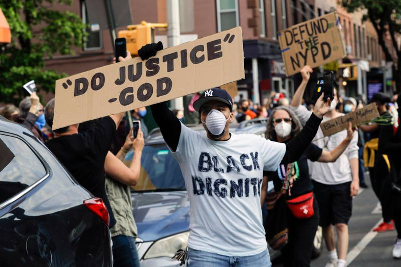 FILE - In this Tuesday, June 2, 2020 file photo, Omar Fernandez takes part in the Prayerful Protest march for George Floyd in the Brooklyn borough of New York. Floyd died after being restrained by Minneapolis police officers on Memorial Day, May 25. (AP Photo/Frank Franklin II)