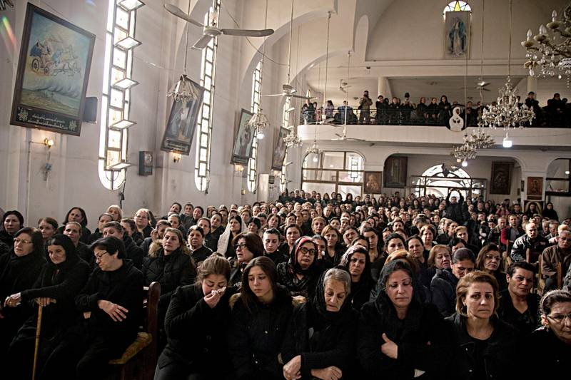 People attend the funeral of Said Abdel Ahad, a Christian fighter of the Syriac Military Council, in Hassakeh, Syria, Friday, Nov. 22, 2019. Ahad was killed in Turkish offensive near Tal Tamr. (AP Photo/Baderkhan Ahmad)