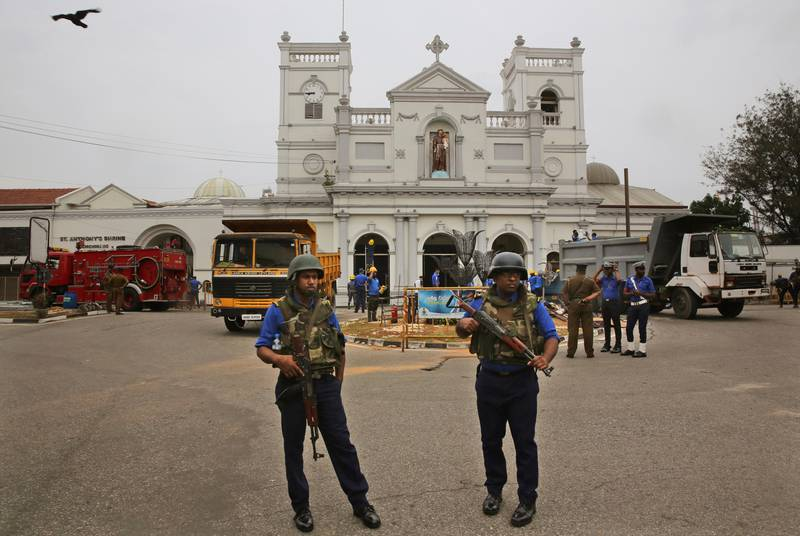 Sri Lankan Naval soldiers stand outside damaged St. Anthony's Church, in Colombo, Saturday, April 27, 2019. Sri Lankan security forces have found 15 bodies, including six children, after militants linked to the Easter bombings set off explosives during a raid on a house in the country's east. (AP Photo/Manish Swarup)