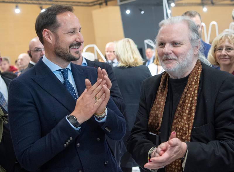 Haakon, Crown Prince of Norway, left, meets with author Jon Fosse, right, as he visits book fair in Frankfurt, Germany, Wednesday, Oct. 16, 2019. Norway is this year's honorary guest at the Book Fair.Boris Roessler/dpa via AP)