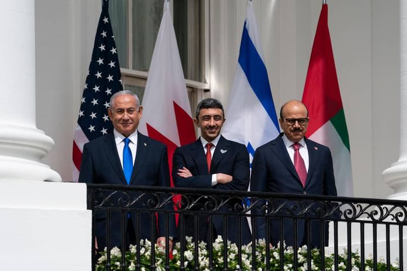 Israeli Prime Minister Benjamin Netanyahu, left, United Arab Emirates Foreign Minister Abdullah bin Zayed al-Nahyan, and Bahrain Foreign Minister Khalid bin Ahmed Al Khalifa stand on the Blue Room Balcony during the Abraham Accords signing ceremony on the South Lawn of the White House, Tuesday, Sept. 15, 2020, in Washington. (AP Photo/Alex Brandon)