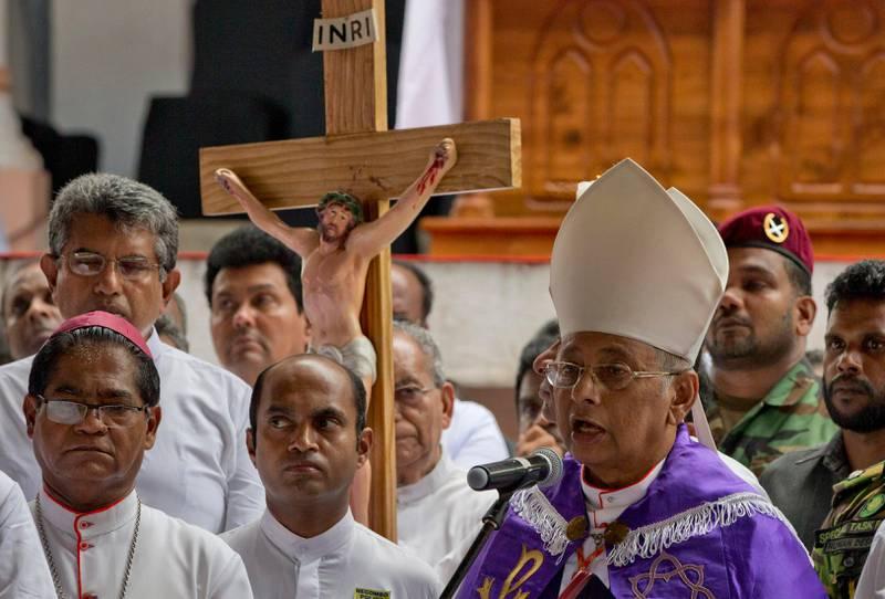 Cardinal Malcolm Ranjith speaks during a funeral service for Easter Sunday bomb blast victims at St. Sebastian Church in Negombo, Sri Lanka, Tuesday, April 23, 2019. (AP Photo/Gemunu Amarasinghe)
