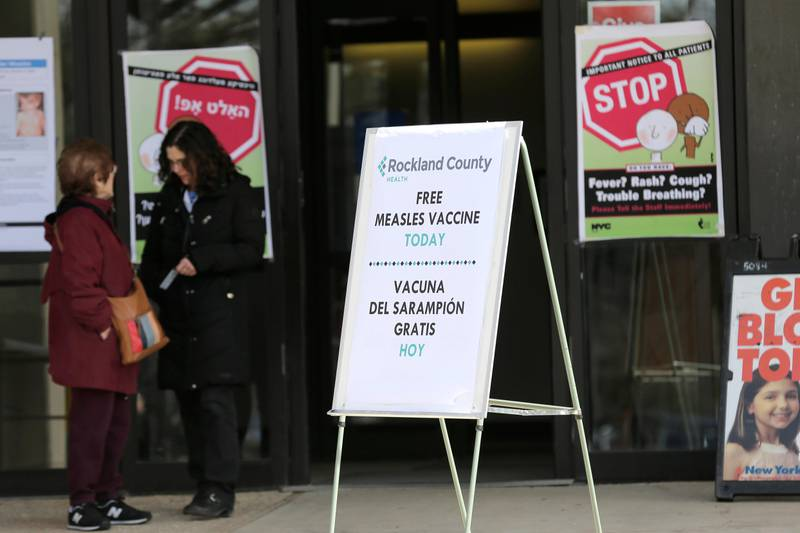 Signs about measles and the measles vaccine are displayed at the Rockland County Health Department in Pomona, N.Y., Wednesday, March 27, 2019. The county in New York City's northern suburbs declared a local state of emergency Tuesday over a measles outbreak that has infected more than 150 people since last fall, hoping a ban against unvaccinated children in public places wakes their parents to the seriousness of the problem. (AP Photo/Seth Wenig)